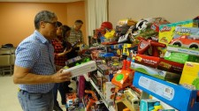 Dr. Norman Quintero collecting Toys for Children in Puerto Rico