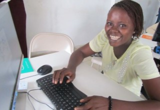A young African girl learning computer skills on Cudoo.com