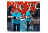 Volunteers take their message directly to local residents at a drug information booth in the heart of Brussels.