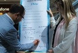 A London city councillor signs the Drug-Free World pledge to live a drug-free life.