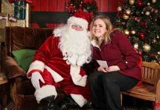 Santa stands ready to hear the Christmas wishes of visitors to Winder Wonderland at the Church of Scientology Community Centre