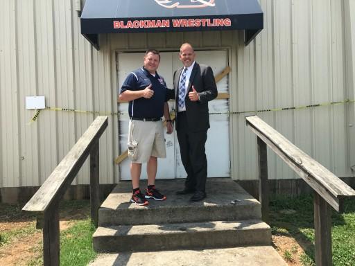 Check Into Cash Donation Helps Rebuild Wrestling Facility