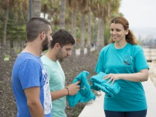 She enlists the help of other volunteers and gives them sets of the turquoise T-shirts of the Foundation for a Drug-Free World.