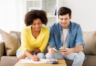 Happy Couple Doing Finances