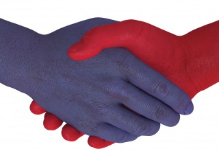 Red and Blue Hands Shaking