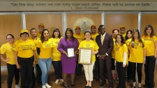 Florida State Senator Daphne Campbell and the Volunteer Ministers of the Church of Scientology Miami, where the senator (center) presented the VMs with a proclamation in recognition of their help.
