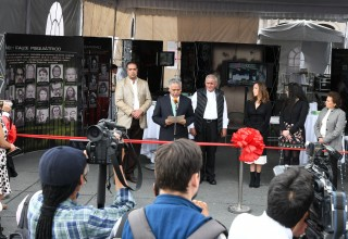 Cutting the ribbon to the exhibit