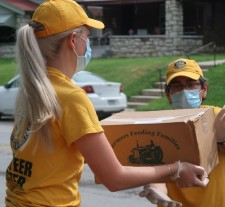 Volunteer Ministers brave triple-digit temperatures to bring fresh fruit and other staples to needy Kansas City families, participating in food drives organized by three local churches.