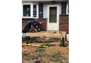 Union Carpenters Hard at Work Building a Wheelchair Ramp