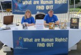 Volunteers from the Church of Scientology Seattle manned the Youth for Human Rights booth at the Kent International Festival