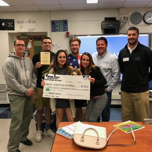 Educators of America and Grand Island High School Yearbook Class Donates Computer Lab
