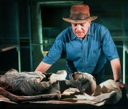 Hawass examines mummy.