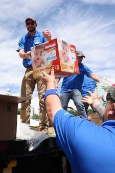 Volunteers Distribute Diapers to Nonprofits in Need