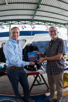 Aggressor Chairman and CEO Wayne Brown and Angelo Allegretta, Aggressor's 300,000th Traveler