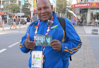 An athlete from the Solomon Islands with his copy of Truth About Drugs