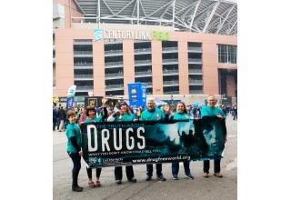 The Drug-Free-World volunteers brought their drug prevention campaign to CenturyLink field on a game night to share the program with Seahawks fans