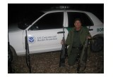 Officer Borkovich with some of the guns used by illegal immigrants