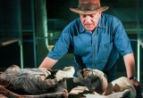 Dr Hawass examines a mummy.