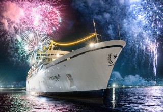 Departing from Bridgetown, Barbados, with a fireworks farewell.