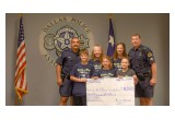 Handing off $11,000 to the Dallas Police