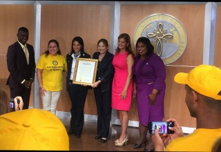 Senator Campbell presents the proclamation to the lead Volunteer Minister and executives of the Church of Scientology Miami.