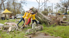 Scientology Volunteer Ministers clear fallen trees out of a Louisiana graveyard