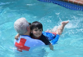 Master Julian learning how to swim