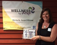 Birdy Dahl accepts Wellness by Design Award for DriSteem
