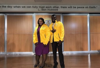 The senator and her aide accept Volunteer Ministers jackets at the Church of Scientology Miami.