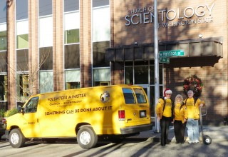 Scientology Volunteer Ministers load up their van with donated goods for those in need.