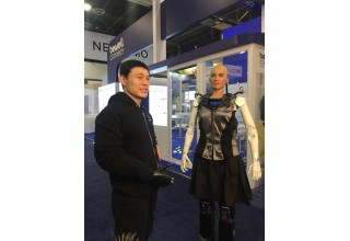 Double Amputee Athlete Mincheng Ni Wears BrainRobotics' Smart Prosthetic Hand and Interacts with Sophia, the World's First Robot Citizen from Saudi Arabia