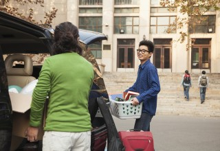 College Student Moving into Dormitory