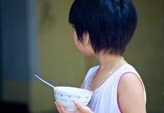 Vietnamese girl waiting for her rice