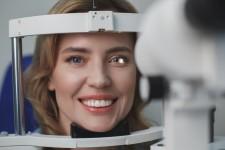 Smiling Woman at Eye Examination