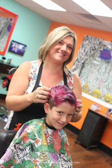 A young client getting his hair styles at Wild Styles