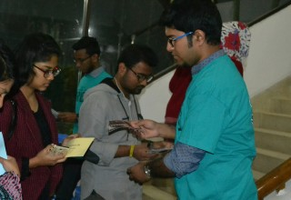 Handing out copies of Truth About Drugs booklets to students before the BRAC University seminar