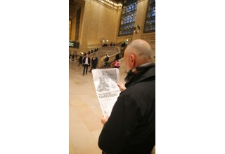 Commuter Reading Ad at Grand Central Station