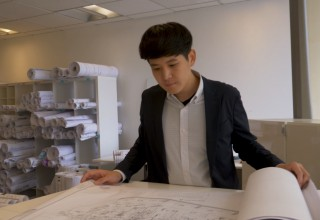 Daniel Choi reviews plans prior to a submittal