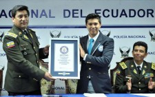 The Guinness World Record representative for Latin America presented a certificate to the National Ecuador Police for the record-breaking number of individuals signing their drug-free pledge.