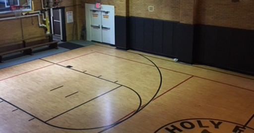Greatmats Wall Mats Bring Peace of Mind to 135-Year-Old Holy Family School Gym