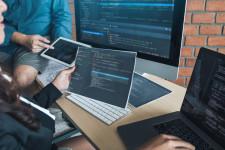 Web engineers working on program codes on computers