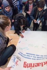 Students signed a pledge signifying their commitment  to combating discrimination—a factor underlying most  cases of bullying.