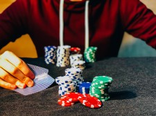 Poker Player with Chips on Table