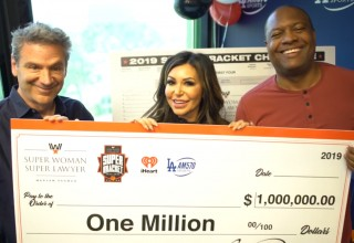 Maryam Parman with $1 million check Fred Roggin and Rodney Peete