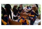 Holiday Heroes Volunteers Packing Backpacks for LA's Homeless Children