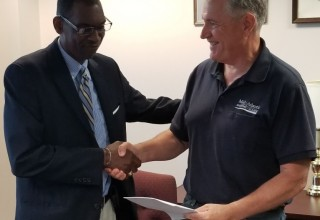 Mr. Jeffery Jones explaining to Capt. Edward Nanartowich the Courses being offered by The American School for International Business which will complement the courses being offered by MAMA.