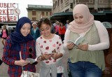 "Volunteers handed out copies of The Way to Happiness on International Day of Friendship created by the U.N. to ""inspire peace efforts and build bridges between communities."""