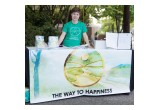 A volunteer welcomed neighbors to a block party organized by the Church of Scientology Seattle and the Seattle chapter of The Way to Happiness Foundation.