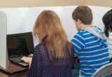 """Students using the 20"""" laptop / chromebook carrel."""
