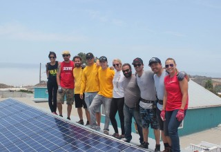 The Sol Collective's volunteers and first donated system